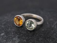 8mm Citrine and Green Amethyst set in Satin Finished Sterling Silver.  A bold and striking double stone ring design, I have christened it my Owl Ring.  This ring is made to order so please let me know your ring size when you place your order.  The ring will come in a black gift box with a black bow.  FREE SHIPPING  To visit my shop, please go to https://www.etsy.com/shop/williamwhite  All jewellery is hand made by me in Cornwall, south-west England