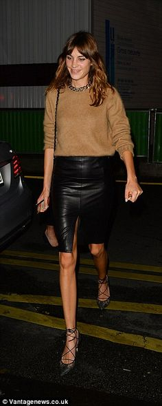 Style star: Alexa ticked all the boxes in her autumn chic ensemble as she teamed a camel jumper with a black leather mini skirt