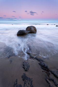 Koekohe Beach, New Zealand.  According to Maori legend, the marble-like Moeraki Boulders on Koekohe Beach are the remains of the ancient Araiteuru canoe that crashed into the Otago coast.