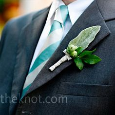 The guys wore lamb's ears on their lapels—some with hypericum berries and others with ranunculus.