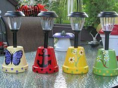 Solar lights in flower pots. Decorate the pots as you wish then place the solar lights in the bottom. Great for camping or a patio! - Gardening And Living Diy Garden, Garden Crafts, Garden Projects, Garden Ideas, Patio Ideas, Garden Pots, Upcycled Garden, Garden Whimsy, Garden Junk