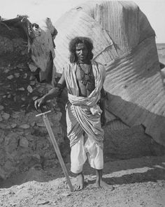 A Beja Warrior, this photo was taken in but the dress of these tribesmen had not changed since their fathers and grandfathers fought the British under the banners of the Madhi. African Culture, African History, African Art, Rudyard Kipling, East Africa, North Africa, Tribes Of The World, Horn Of Africa, African Tribes