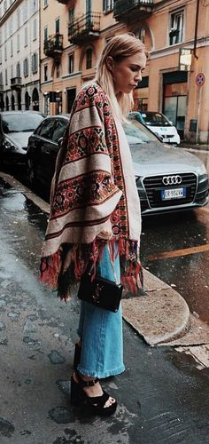 A Poncho, a White Shirt, Jeans, and Platform Shoes