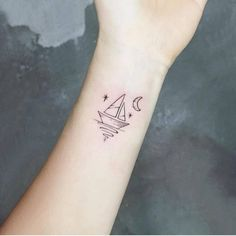 Small sailboat on the inner wrist. Tattoo artist: Ida