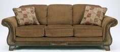Ashley Furniture Signature Design - Montgomery Sofa with 2 Throw Pillows - Classic Style - Mocha. Assembly required. Series: montgomery. Components included: sofa.