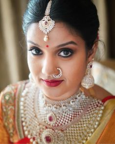 Image may contain: 1 person, closeup Diamond Nose Ring, Gold Nose Rings, Ear Rings, Tikka Jewelry, Wedding Jewelry, Ethnic Jewelry, Nose Ring Jewelry, Diamond Jewelry, Gold Jewelry