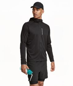 Check this out! Running jacket in fast-drying, breathable functional fabric. Mesh-lined hood, zip at front, chest pocket with zip and a media outlet, and reflective details. Ventilation holes under arms, ribbing with thumbholes at cuffs, and rounded hem. Slightly longer at back. Unlined. Snug fit. Size of chest pocket 4 x 7 in. - Visit hm.com to see more.