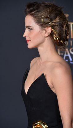 Emma Watson goes for the gold with a hair accessory styled after Greek goddesses' crowns