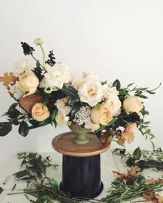 Loving this autumnal take on an ivory palette - ivory garden roses from @rosestoryfarm were at their peak of perfection for this centerpiece!  #wildgreenyonder #flowers #virginiaflorist