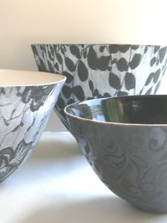 Black and white earthenware lace bowls by Sandy Godwin.  finer than I usually go for but so beautiful.