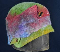 Felted Cloche from raw alpaca.  Felted, dyed, pieced out, steamed and formed, sewn and embellished.