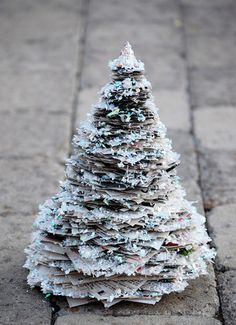 Christmas tree made out of newspaper and glittered up.  A little variety from the bottle brush trees.