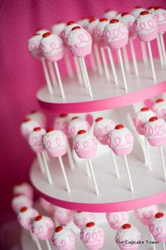 Cake Pop display tower...take 2-3 round pieces of styrofoam, layer them like a cake, cover the sides with flourishes or ribbon...tada.. diy cake pop tower!