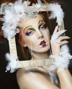 Makeup, Concept & Styling: Iana Willkofer Photographer: Lucie Balde   Creative makeup, avantgarde, blue eyes makeup, flawless, tears, feather, cover photo, fashion, beauty, dark beauty, editorial