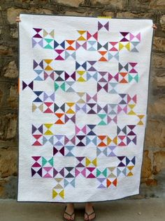 I REALLY want to make this quilt. I just love the solid colors and the design is perfect for someone who makes a lot of mistakes and can't line up a seam to save her life (this girl!)  Moda Bake Shop: Charm Crossing Quilt