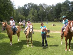 Horses and riders waiting patiently at WeHaKee Camp for Girls in Winter, WI.