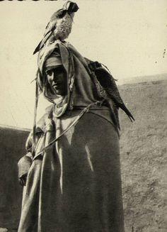A Tunisian falconer with his birds, 1920s.