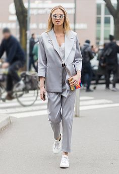 To nail your first day in a new job, start with a lush silky suit in cool grey and layer under a cami. Add fresh white treads (cos you're obvs gonna get put through your paces) and some mirror sunnies to emulate that professional look. Finish with a burst of colour (aka personality): think a bold printed box clutch. Work. It