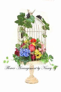Artificial Flower Arrangement In a Rustic Birdcage. www.facebook.com/IrisFloralDesignbyNancy