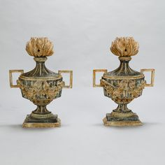 Pair 19th Century Italian Carved Wood Decorative Urns  --  Pair circa 1880 Italian decorative urns from a convent. Hand carved from wood with a pedestal base, floral details in relief, open work handles at the sides and flames at the top.  Sold and priced as a pair.  --   Item:  7225  --  Retail Price:  $3695