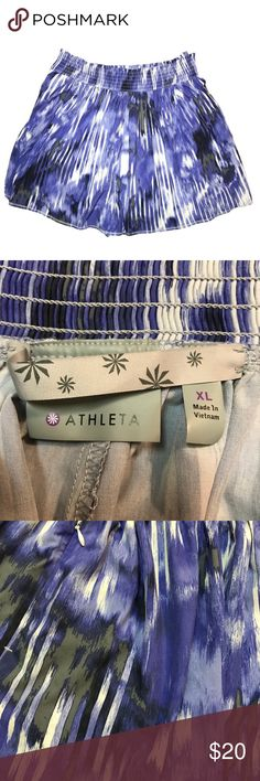 "Athleta XL Shorts With Pockets Athleta XL Shorts With Pockets Features two zippered Pockets , one on each side. Elastic waist band lots of stretch Great purple grey fashion print  Measures 18"" waist, 16"" length 5"" inseam Excellent condition no stains snags etc Pet and smoke free home #plussize #athleta # workout Athleta Shorts"