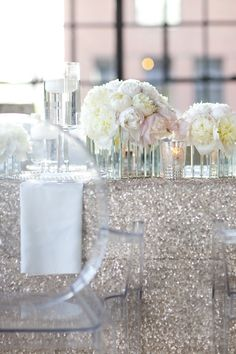 Silver sequinned linen + ghost chairs + white peonies. Perfection. Photography by ykvision.com, Styling, Tablescape, Floral Event Design by zestfloral.com, Invitation Design Engraved Perspex Design Details by astridmuellerexclusive.com