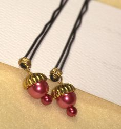 These adorable tear drop cranberry pearls w/gold accents make a stunning addition to an updo
