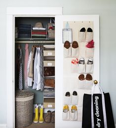 Smaller items, like scarves, belts and mementos, are sorted into small boxes. A shoe caddy, hung on the back of the closet door, gets shoes off the floor. Piles of sweaters and linens stay vertical with shelf dividers. A moody paint colour on the back wall of the closet makes clothing pop.