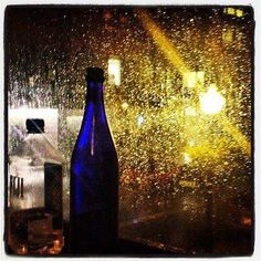 Dinner at GEM Boston. It's pouring out. We LOVE the window seats.