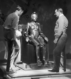 1926 Film director Fritz Lang releases Metropolis, a silent film set in a futuristic urban dystopia. It features a female robot –the first to appear on the silver screen– who takes the shape of a human woman in order to destroy a labor movement.