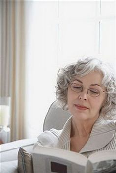 Short Grey Curly Bob.  She's more like 65 or 70, but the hairstyle works, too.