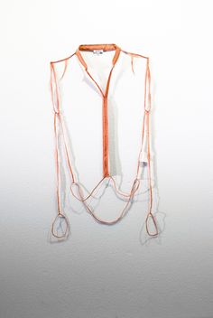 elements of garment cut away revealing only the garments' seams.
