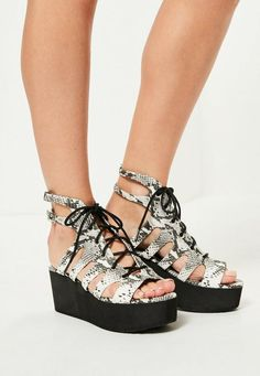7e419271081 Snake print is hawt this summer so grab these grey flatform sandals with lace  up deets