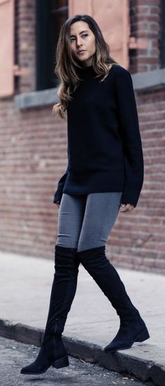 Raquel Paiva wears a pair of over the knee boots with a simplistic black knit sweater and grey skinny jeans.   Boots: Call it Spring, Watch: Great George, Sweater: Uniqlo, Jeans: DSTLD.... | Style Inspiration