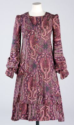 Dress, Barbara Hulanicki, 1971  Barbara Hulanicki (Biba) (1936-)  1971  By 1971 the Biba boutique had grown into a large store stocking a wide range of Biba clothes. There were separate departments for menswear, childrenswear and household accessories. Barbara Hulanicki designed all the clothes and retained control of the colour co-ordination of all other products. This dress, with its swirling paisley design, is typical of the palette used f...