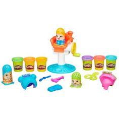 Play-Doh Crazy Cuts Includes unassembled playset, 3 character thimbles, 2 book-molds, 4 accessory tools, and 6 cans of Play-Doh Brand Modeling Compound.