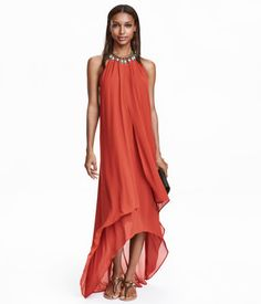 Rust red. Halterneck maxi dress in double layers of textured chiffon with a…