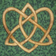 Trinity Love Knot-Heart Shaped Wood Carving-Irish Love Knot Variation.      MEANING:  This is a variation of the Irish Love Knot. It is a heart shape entwined with a Trinity Knot, composed of one line with no beginning or end, representing eternal love of the Great Mystery.$78.00