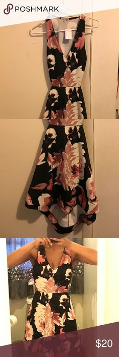 Cute Floral Scuba-Type Dress Cute black floral dress in scuba-feel material... Dress has never been worn, tag still attached • Hi-Low hem• sexy cut out in the back of the dress• Dress s slip-on with no buttons zippers...!😍😍😍 ****SEE SOMETHING HERE, BUT DON'T LIKE THE PRICE? MAKE ME AN OFFER & GET SOMETHING NICE 👠👗👜**** Charlotte Russe Dresses High Low