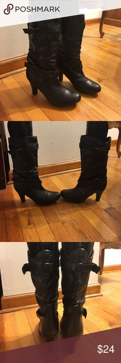 Black Boots Black boots size 10. Boots have a heel on them. Great with jeans or a dress. Super cute boots with cheetah print inside. Worn only once. Shoes Heeled Boots