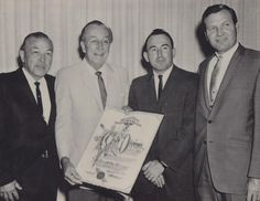 """Awarding Walt: Taken in 1966 this photo shows Walt being given an award by the Southern California Veterinary Medical Association in """"gratitude and appreciation for his immeasurable contributions to the veterinary profession."""""""