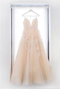 The Ariane gown from wedding dress designer  BHLDN features floral applique  and plunging V- 8081e6b604d