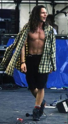 Still nothing hotter than a guy wearing a flannel shirt, shorts and combat boots.... especially when it's Eddie Vedder :D