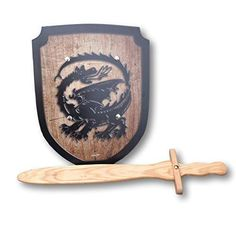 Wooden sword and shield set with a dragon motif. Straight out of the medieval times! Perfect addition to a knight's costume or perhaps a prince? Swashbuckling with pirates or alongside the three musk. Toddler Boy Toys, Toys For Boys, Kids Toys, Horse Costumes, Boy Costumes, Montessori Activities, Montessori Toddler, Dragon Shield, Knight Costume