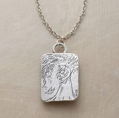 """Aww!!  (""""Be Brave"""" Necklace.  Jes MaHarry inscribes the back of her mother-and-child talisman, """"I am always with you. Be brave, have courage and love life."""")"""