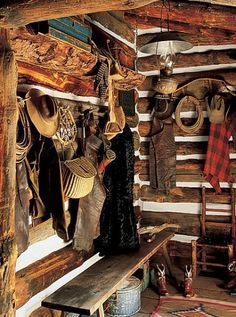Double RL Ranch in Colorado: Little Bear Cabin. The mudroom serves as a storage area for leather chaps, riatas, stirrups, early snowshoes from Taos and Native American-made fishing accessories.