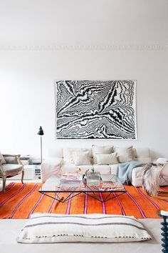 Living room with orange rug