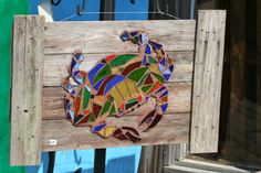 mosaic glass crab on weathered wood