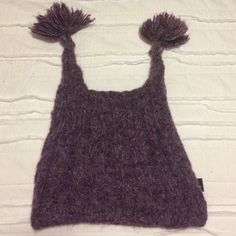 Peruvian Trading Co. Purple winter hat with poms Adorable Peruvian acrylic purple winter hat with two tassels on top.  Nothing wrong with it, but I moved to FL 8 years ago and think it's probably time to let it go  Accessories Hats