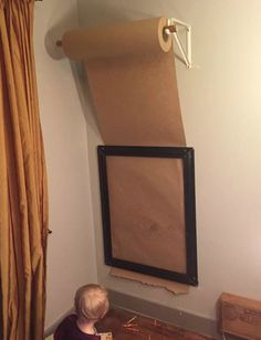 Take a large roll of paper and pull it down through a picture frame for the kids to color on instead of your walls ... you could also hang a basket for crayons or build a stand for all kinds of coloring tools.